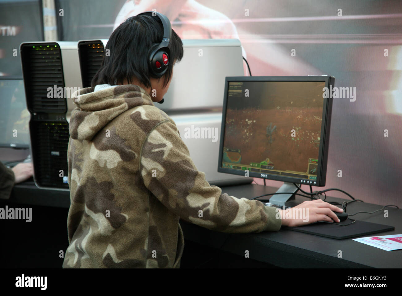 Boy playing computer game at London games show - Stock Image