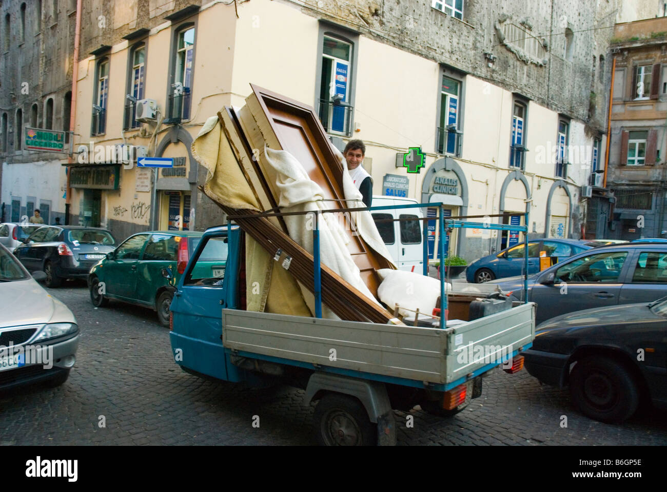 Furniture delivery van in centro storico quarter of naples italy europe stock image