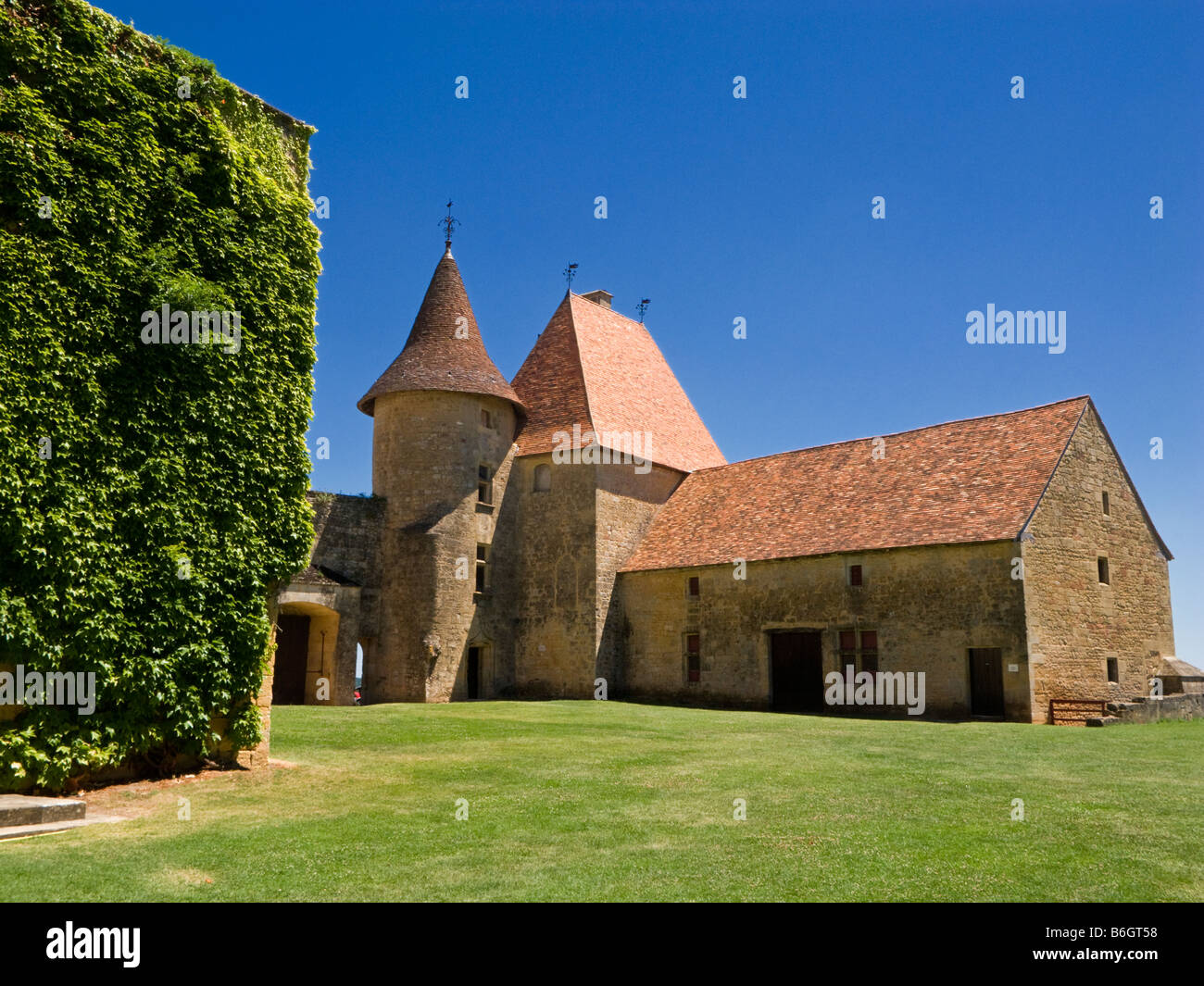 Old buildings in the courtyard of the Chateau de Biron Dordogne France Europe - Stock Image