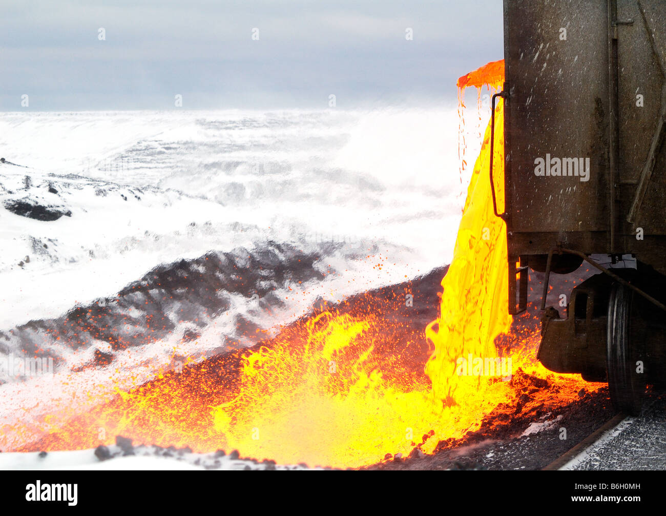 This is one of the more spectacular sights in the mining industry. Pouring slag is very much like flowing lava. - Stock Image