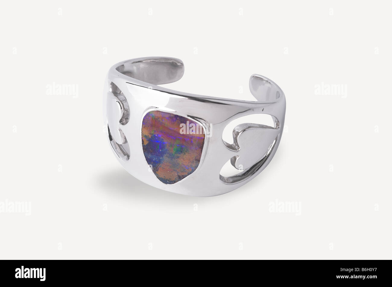 Opal and silver bangle on white background - Stock Image