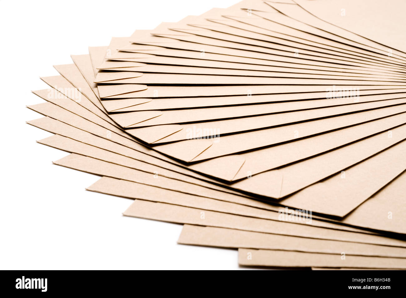Pile of A5 brown envelopes - Stock Image
