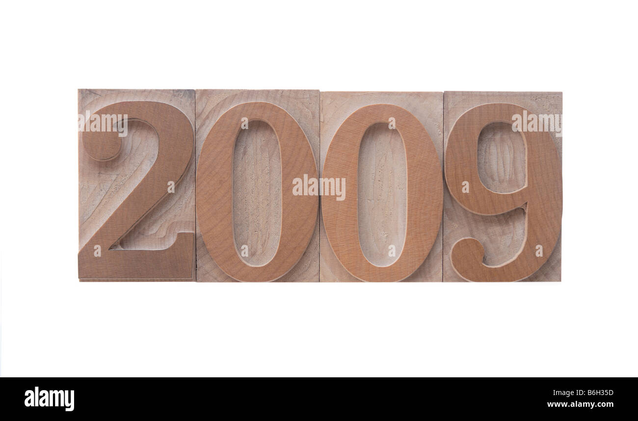 the numbers '2009' in old ink-stained wood type - Stock Image