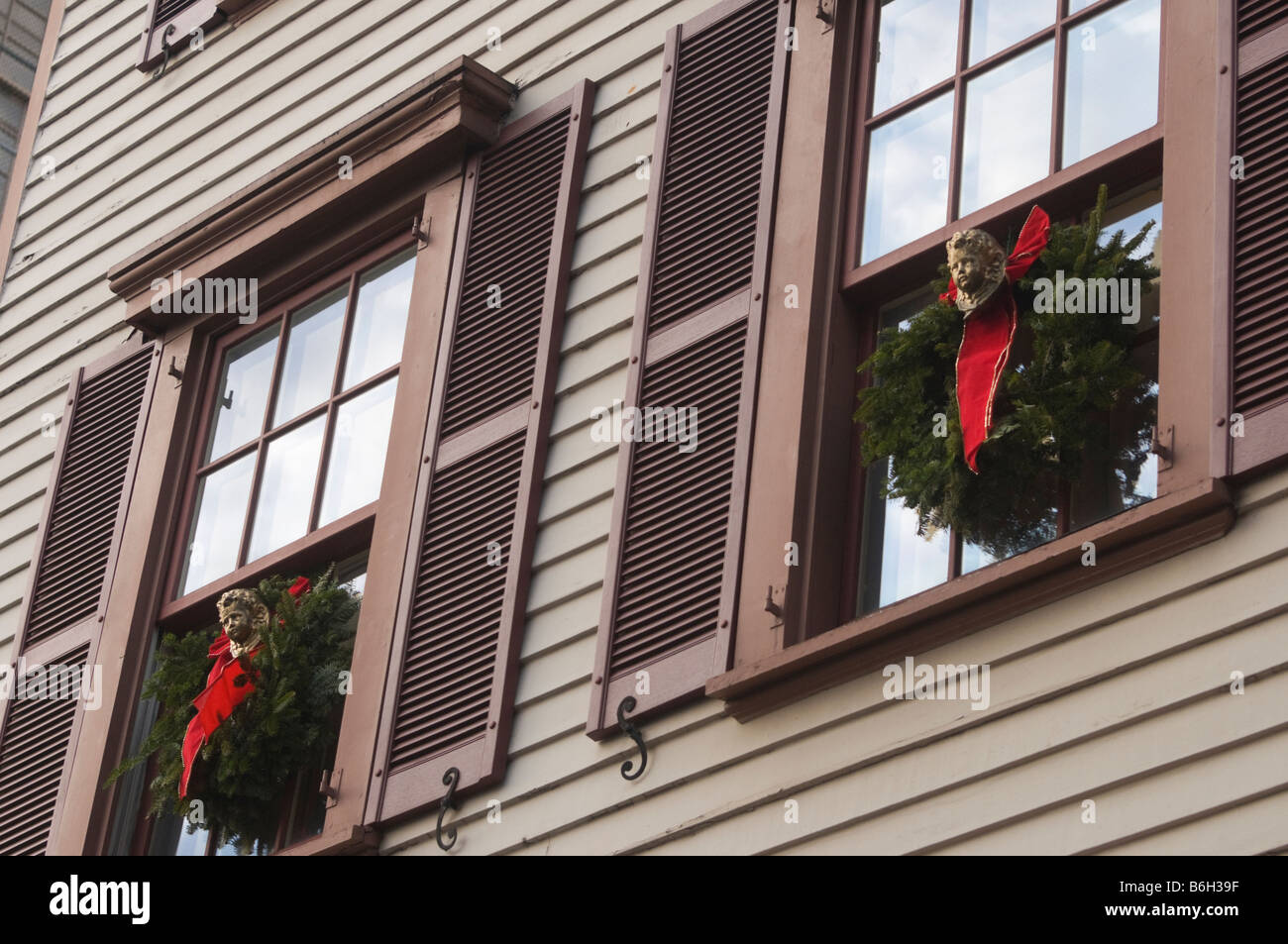 New York NY 12 December 2008 Shuttered windows with Christmas wreaths adorn  facade of 17 Grove Street ©Stacy - Stock Image