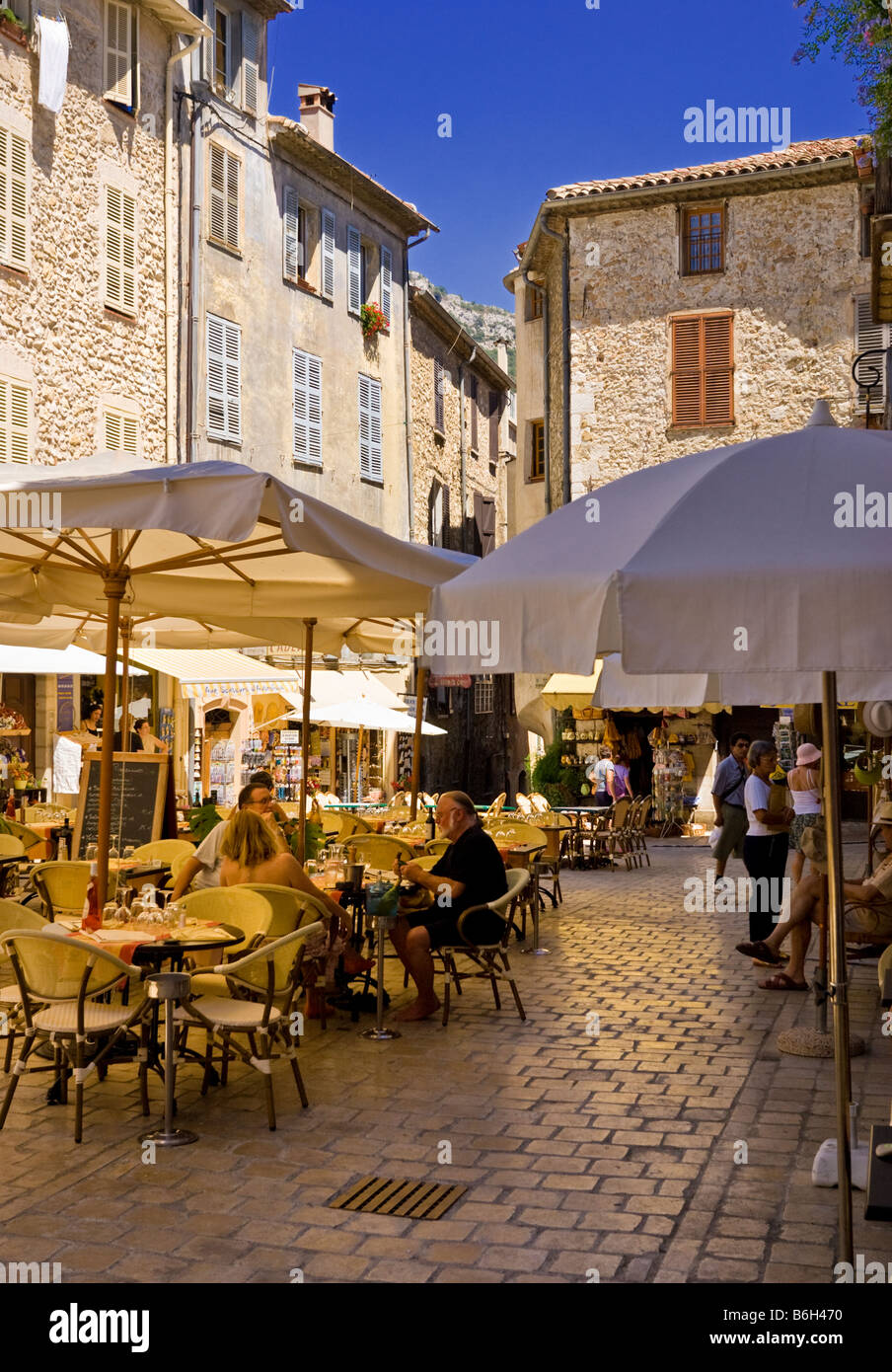 French cafe bar restaurants in the square in the old town of Vence, Cote D'Azur, Provence, France, South of - Stock Image