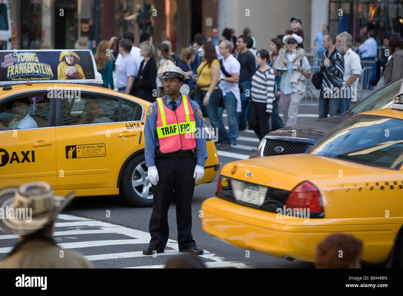 Traffic cop 42nd Street and Fifth Avwenue New York City - Stock Image