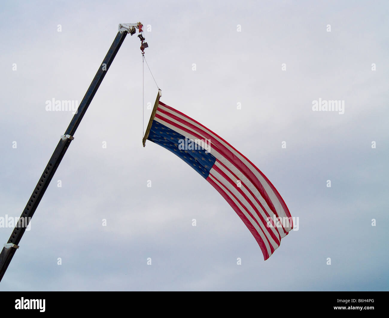 A close up on the American flag suspended from a crane - Stock Image