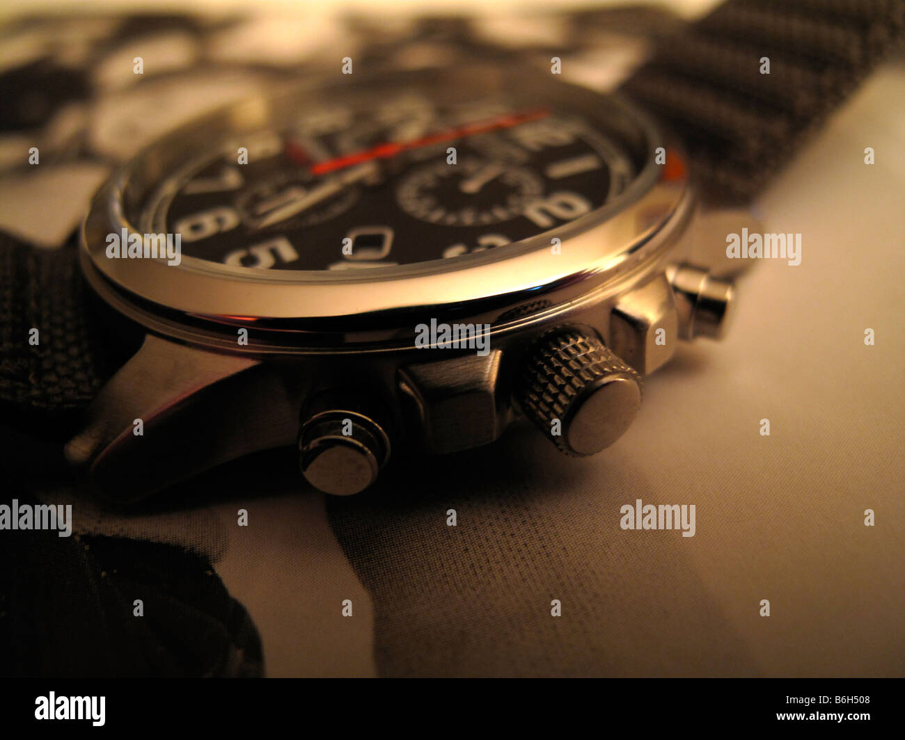 Close up of man's chronograph watch. - Stock Image