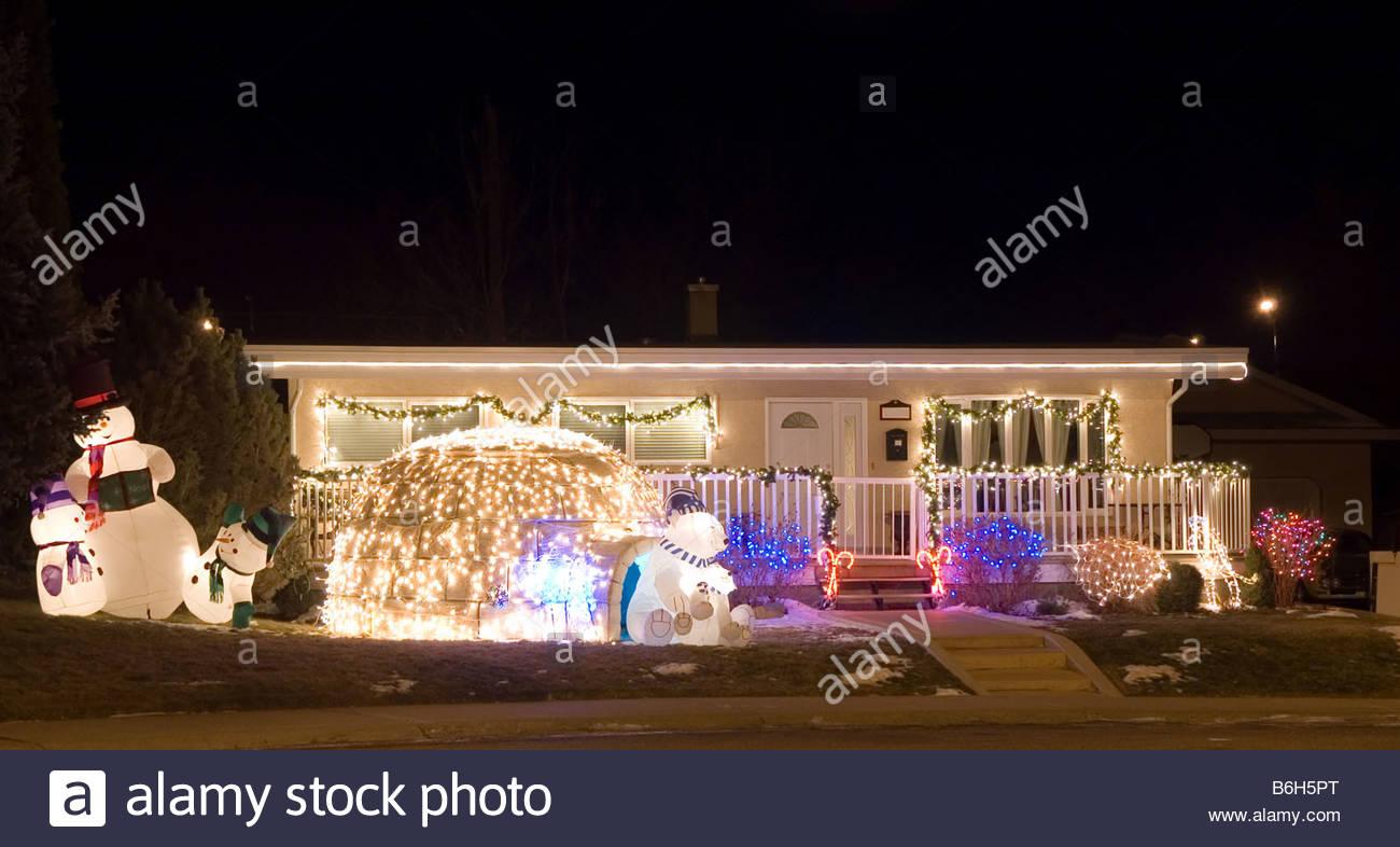 Colorful Christmas Lights On House.House Decorated With Colorful Christmas Lights Featuring