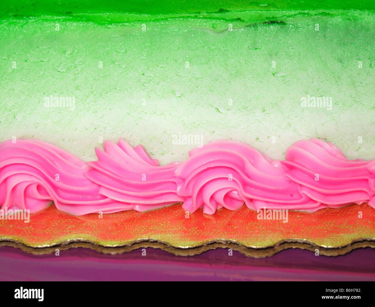 Closeup of bright cake decorations - Stock Image