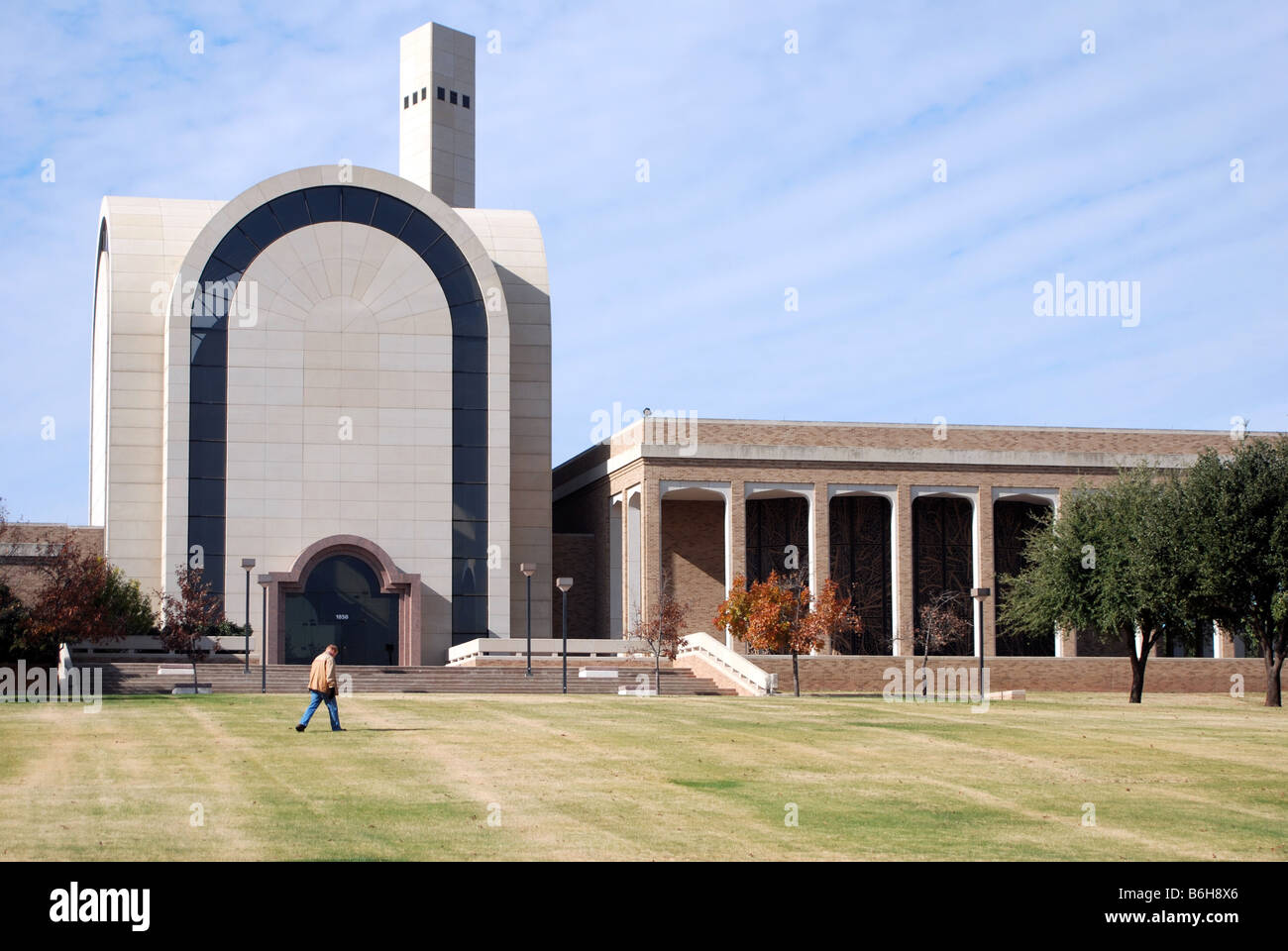 Abilene Christian University Bible Building with man walking in front of it - Stock Image