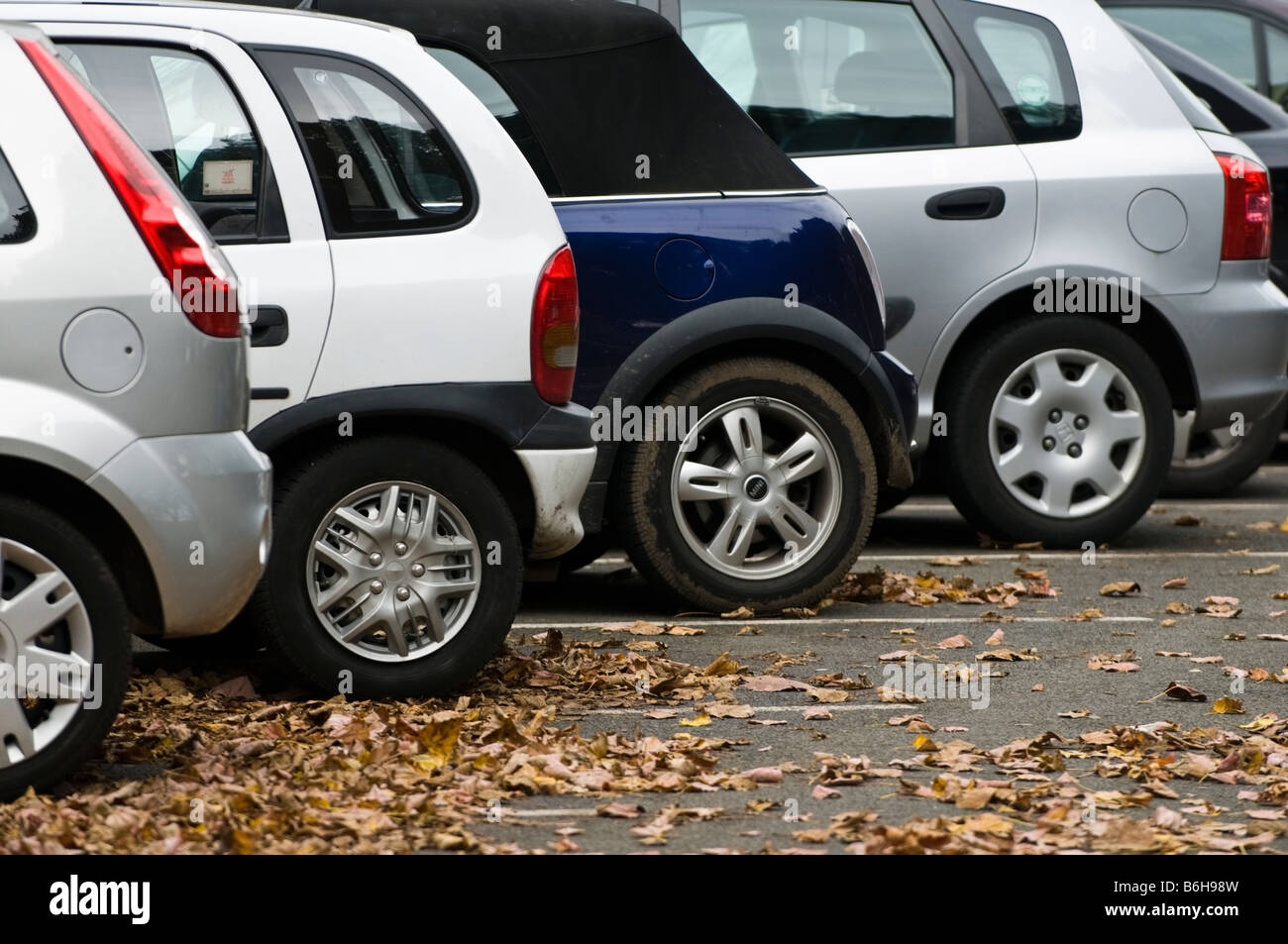 A row of small parked cars - Stock Image