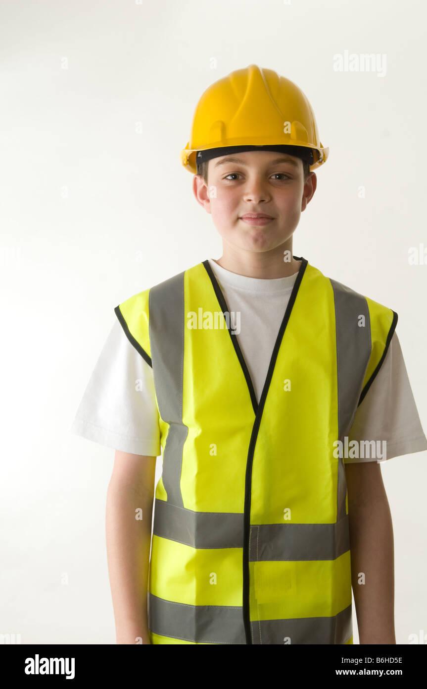 overcautious parent parenting over cautious caution health and safety precautions hard hat hi vis jacket boy kid - Stock Image