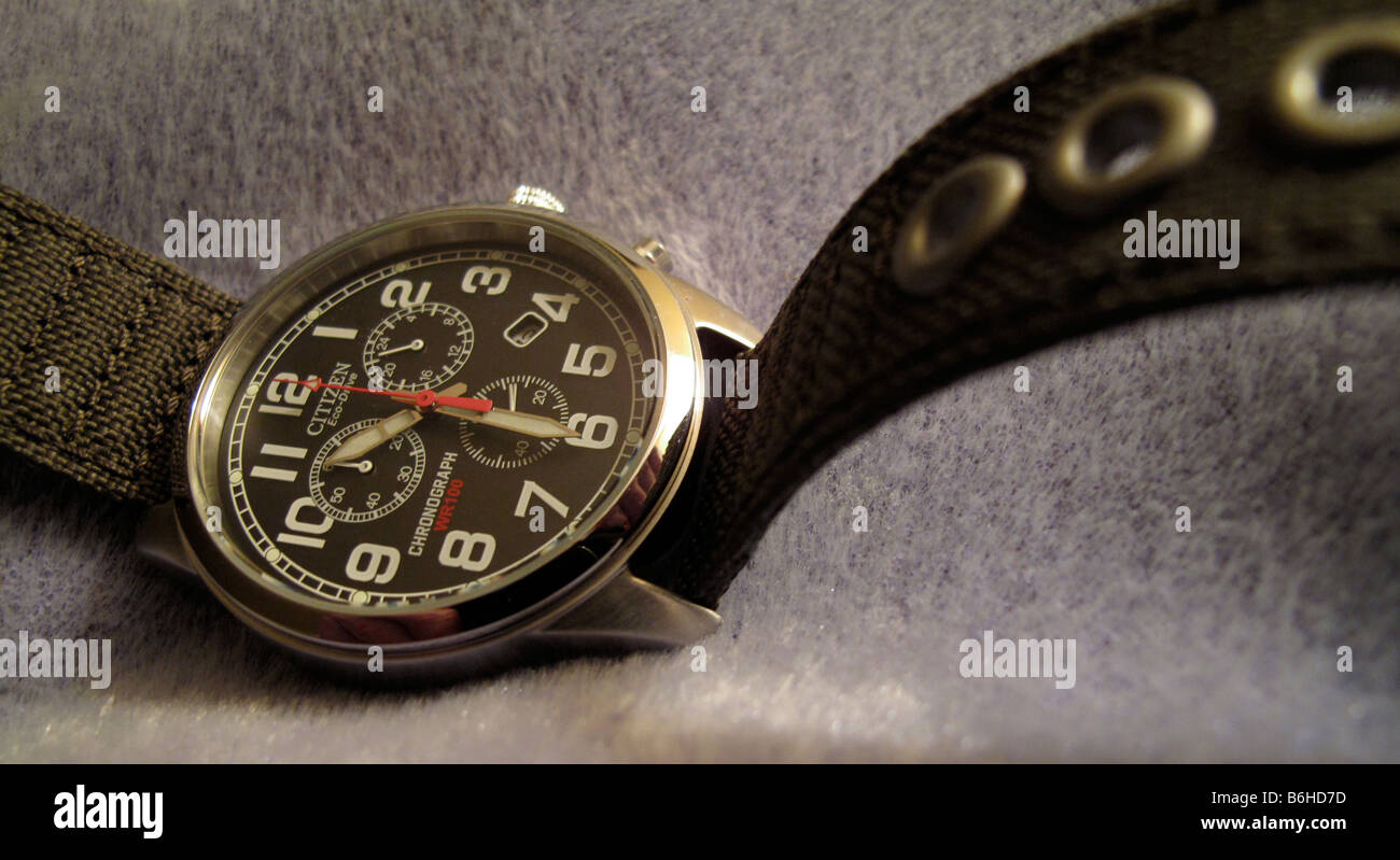 Man's chronograph watch with canvas band. Stock Photo