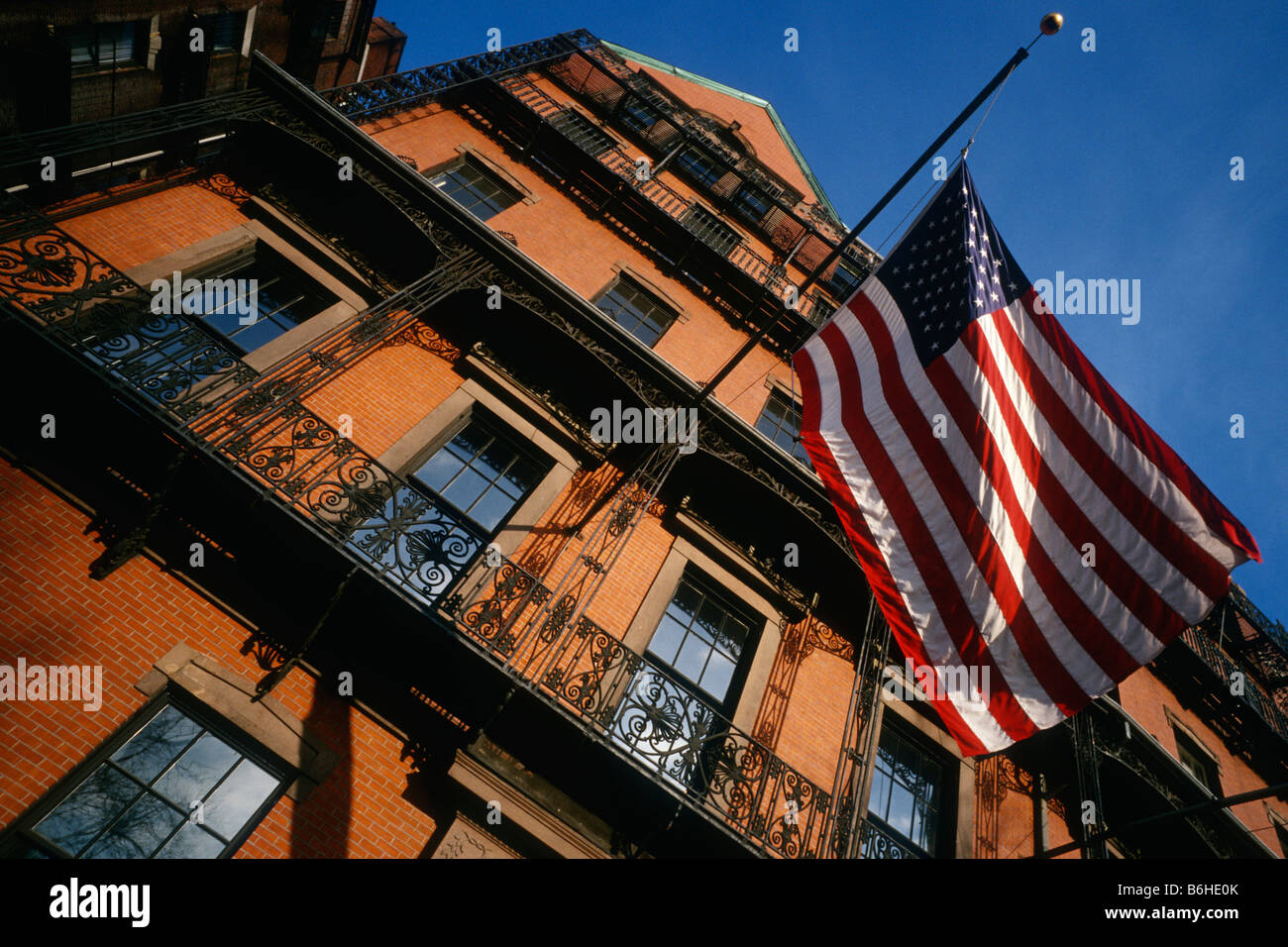 Boston USA Red brick building and Stars Stripes in the historical Beacon Hill district - Stock Image