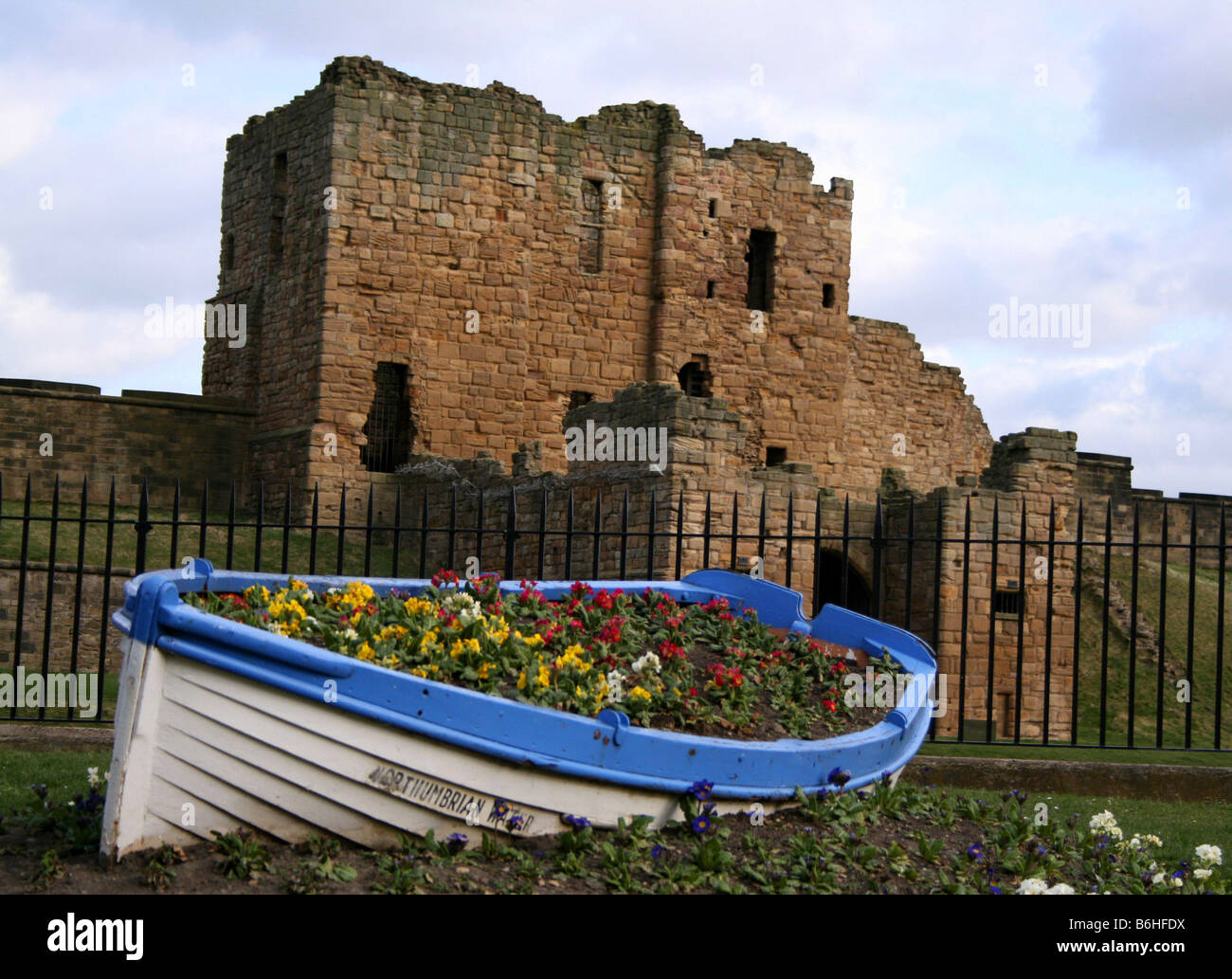 Ruined castle and boat at Tynemouth, North East - Stock Image
