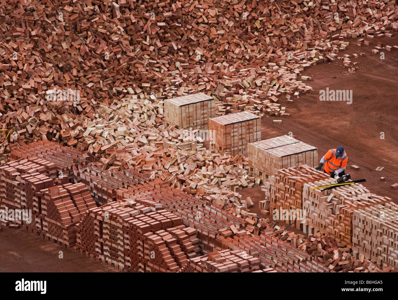A worker sorts through London Bricks for clients at the Kings Dyke facility of Hanson Brickworks near Peterborough - Stock Image