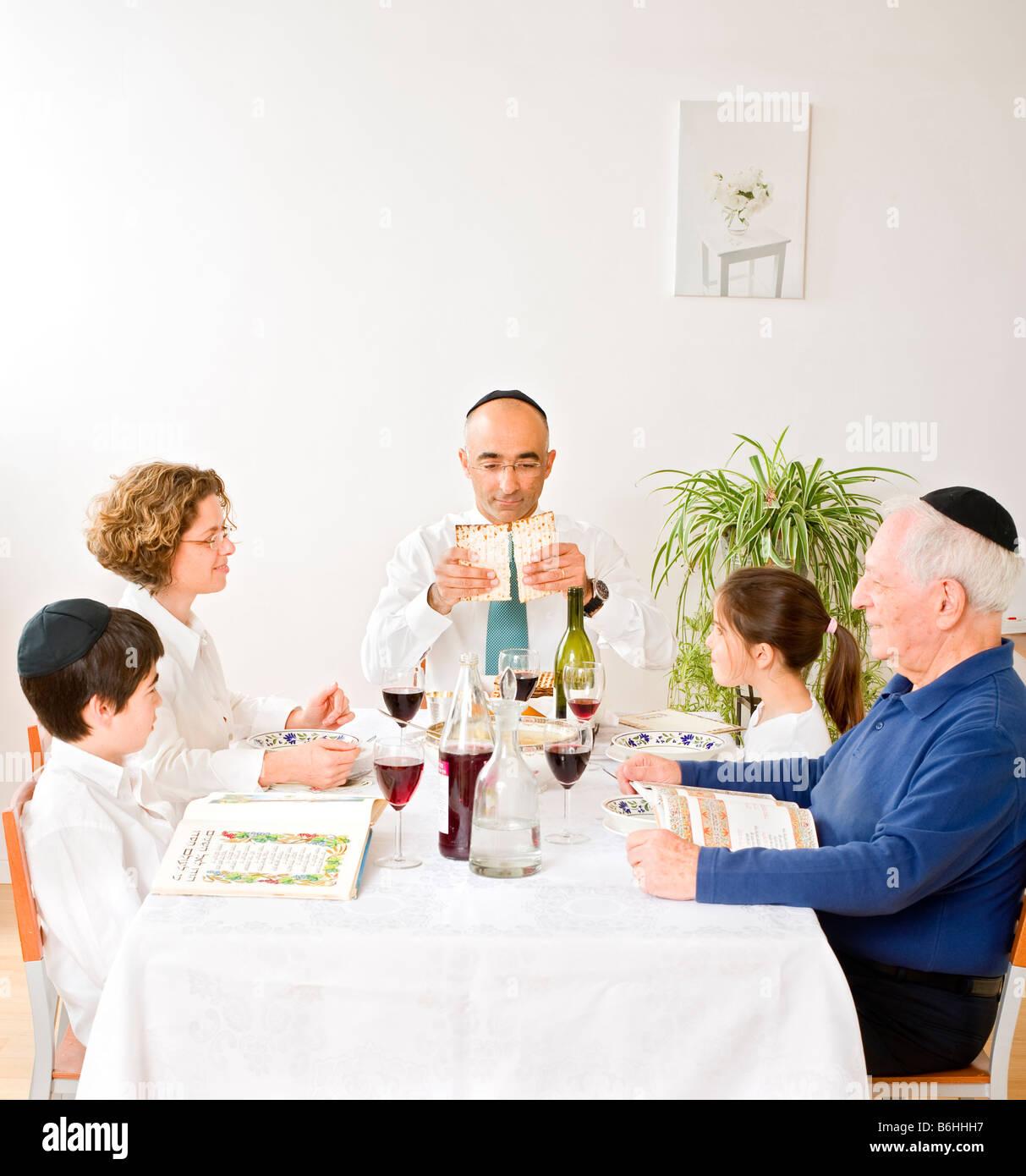 jewish family in seder celebrating passover - Stock Image