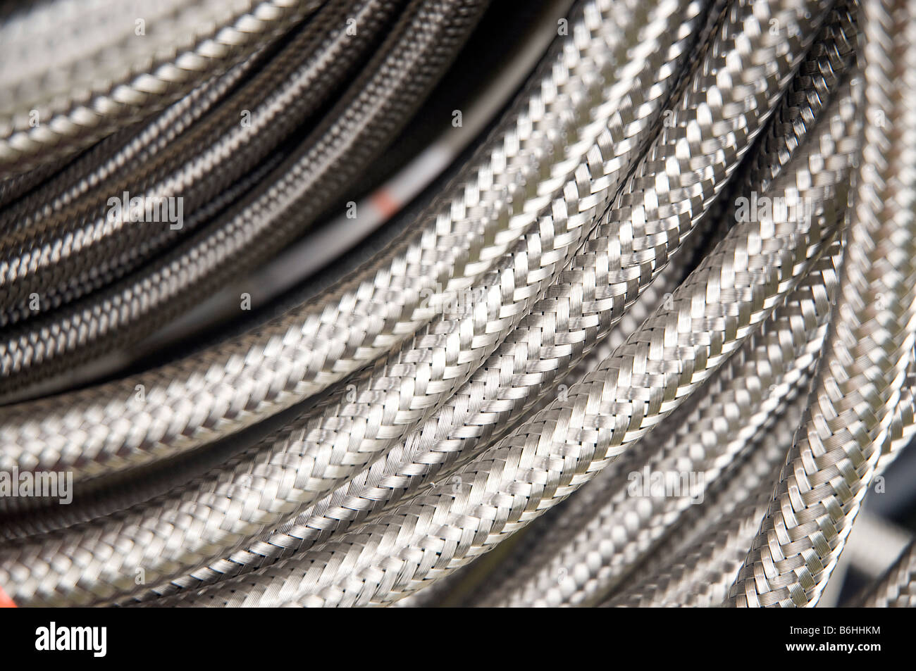Close up of a coil of reinforced hosepipe - Stock Image