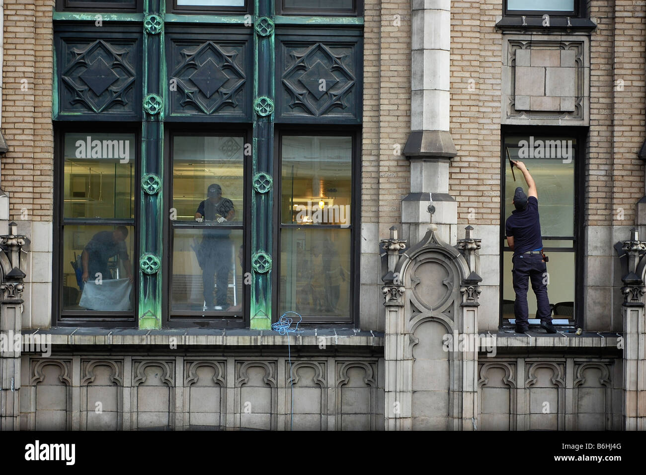 Window Washer Stands On Ledge In New York City Skyscraper For Editorial Use Only