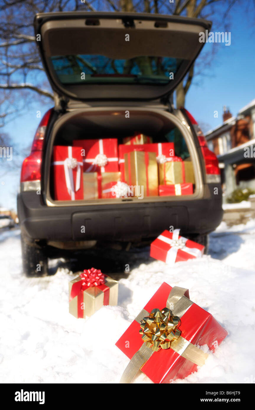 Christmas gifts falling from a trunk of a car - Stock Image