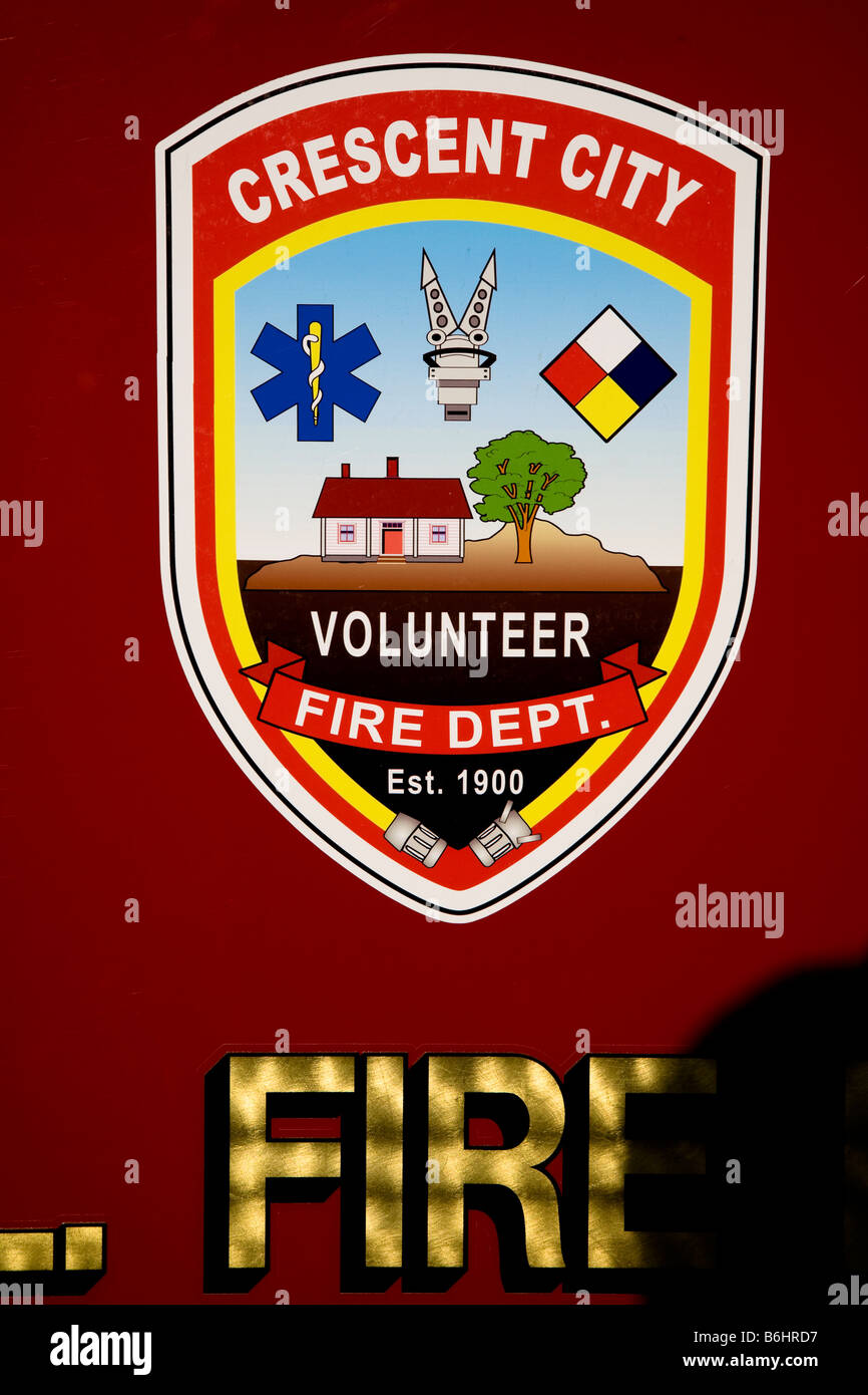 Crescent City volunteer fire department decal badge on the side of a fire truck - Stock Image