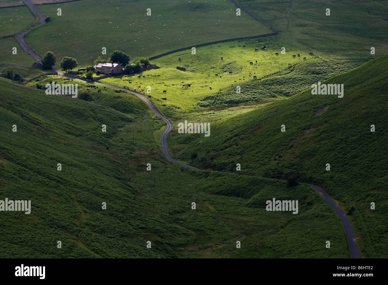 Farm in the Ingram Valley spotlit by a shaft of sunlight in the Northumberland National Park, England - Stock Image