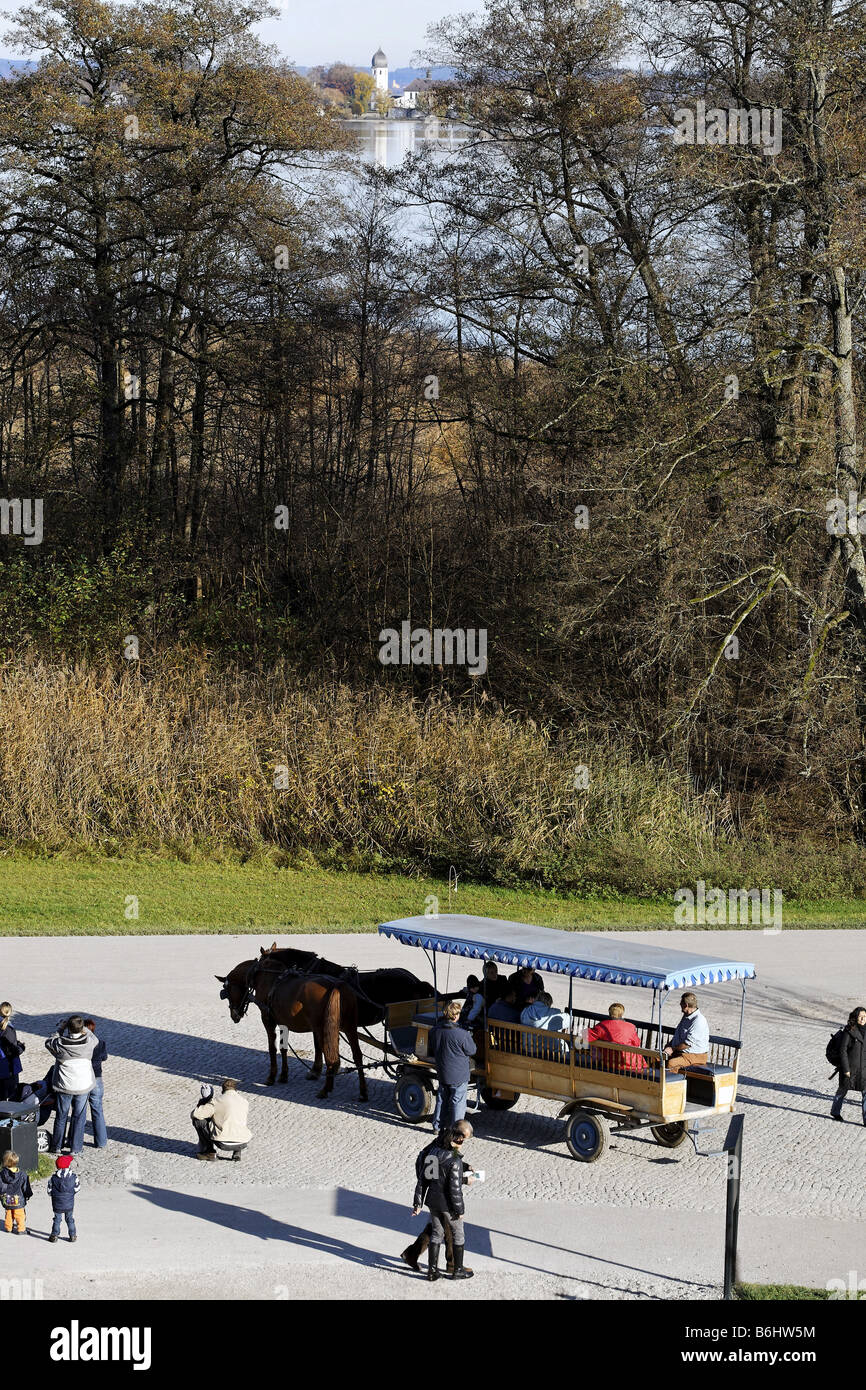 Horse Carriage and view to the Frauen Island from Herren Island Chiemgau Bavaria Germany - Stock Image