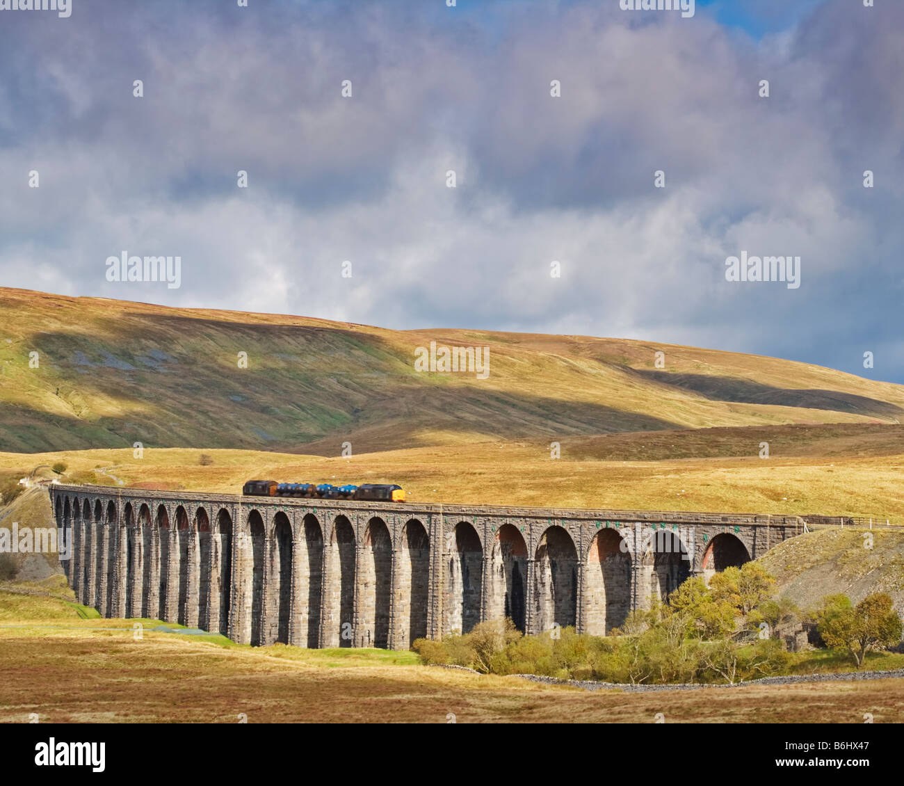 Goods train crossing the Ribblehead Viaduct in the Yorkshire Dales National Park England - Stock Image