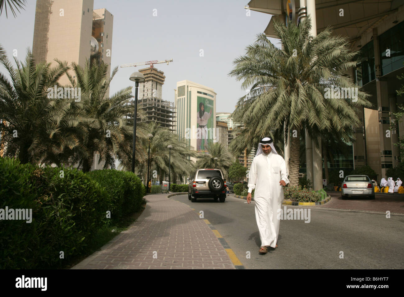 Street scene with Qatari man in traditional clothing on the street of Doha, Qatar. Stock Photo