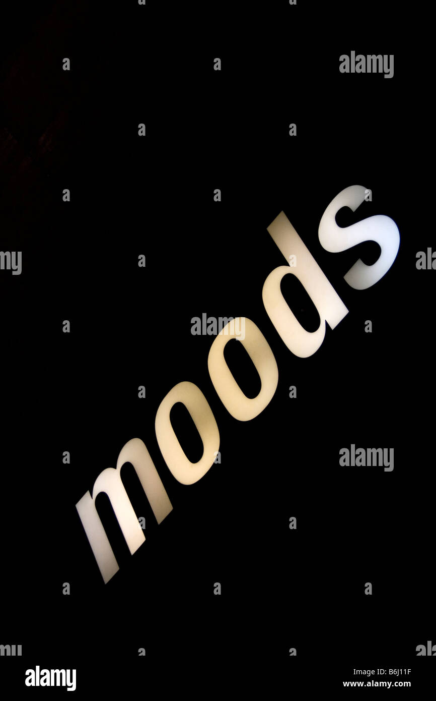 Moods sign in white light projected on a black wall - Stock Image
