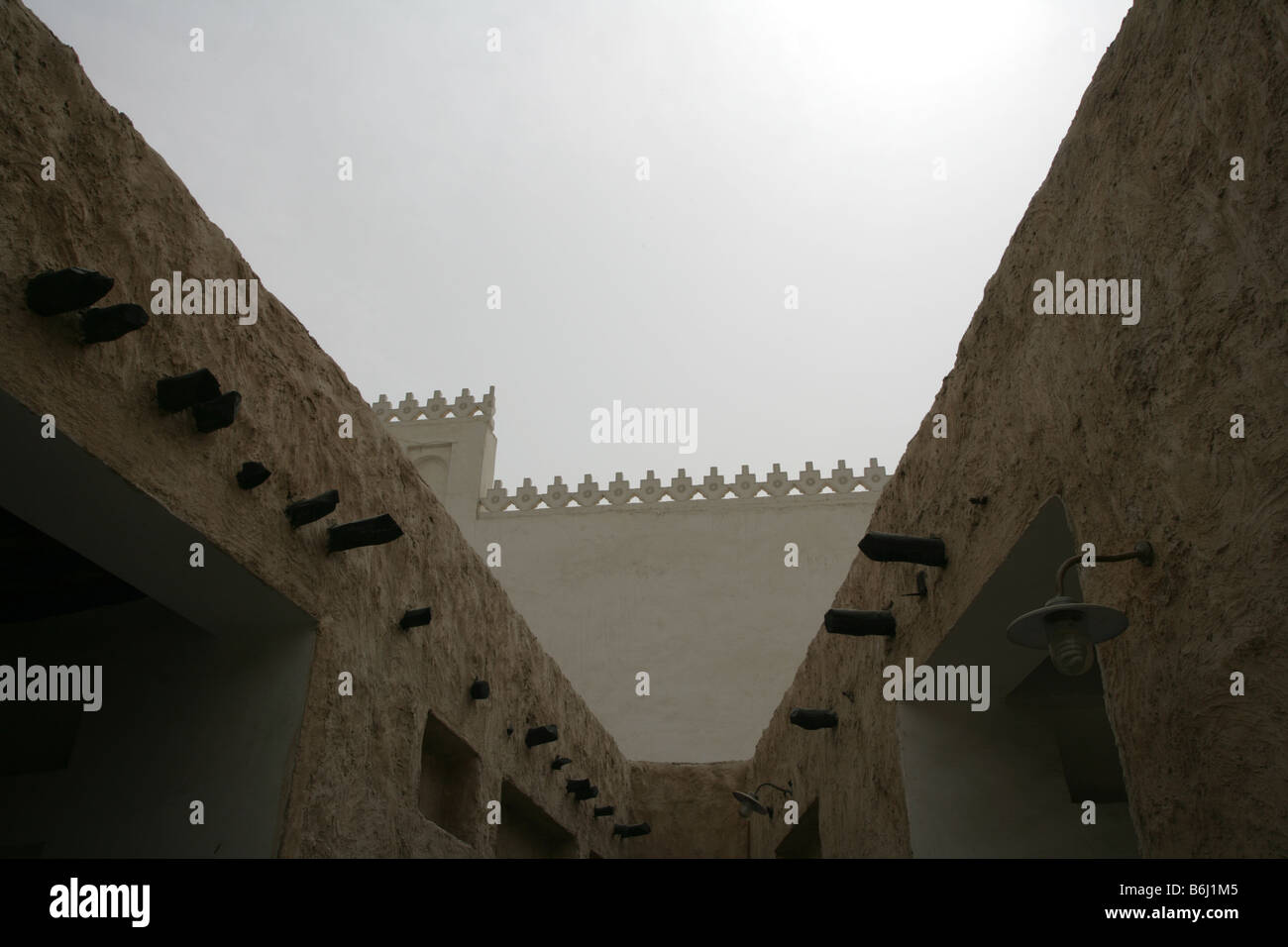 Traditional buildings with protruding 'shandal' beams in Doha, Qatar, Middle East - Stock Image