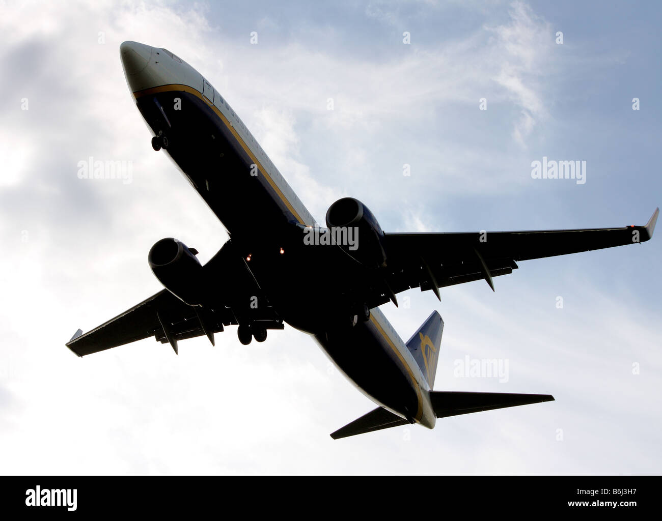 A close up of a ryanair passenger airplane flying overhead and coming in to land Stock Photo