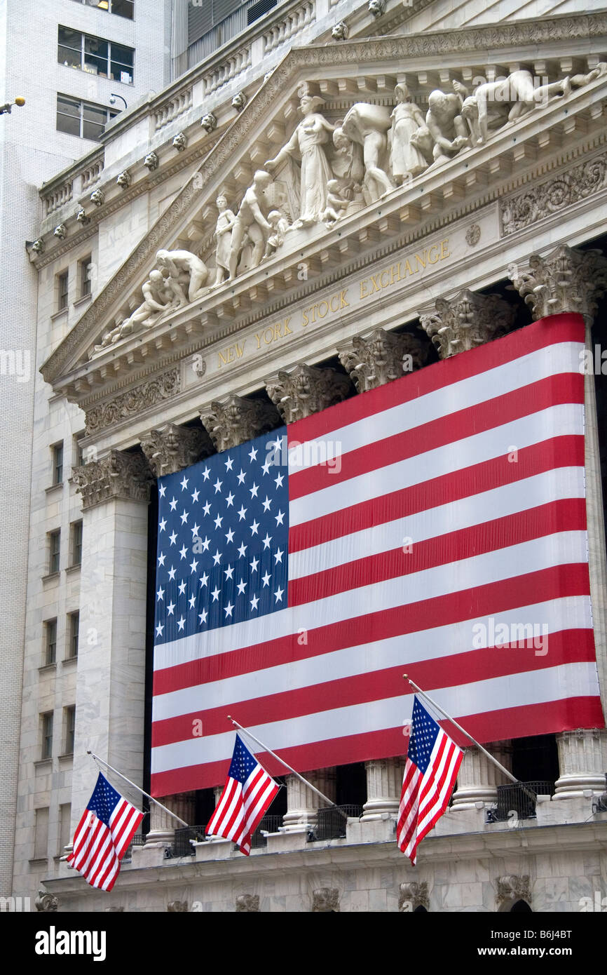 American flags in front of the New York Stock Exchange in New York City New York USA - Stock Image