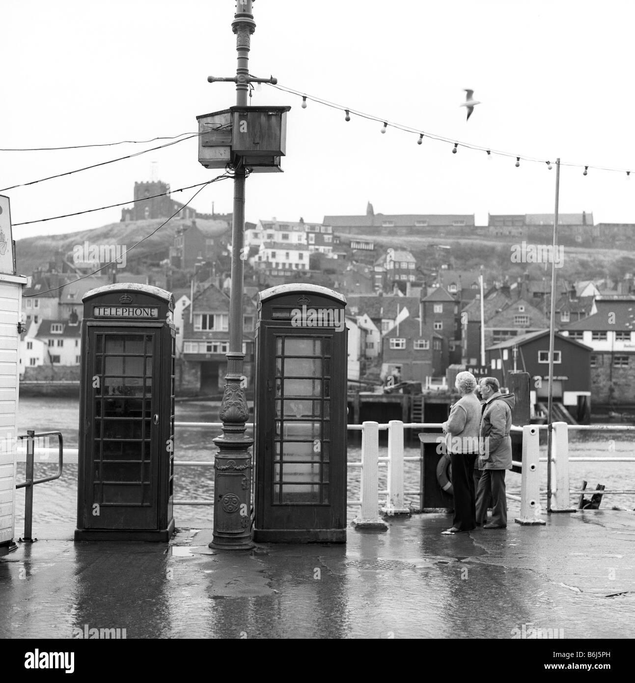 UK England Yorkshire Whitby quayside K6 phone boxes - Stock Image