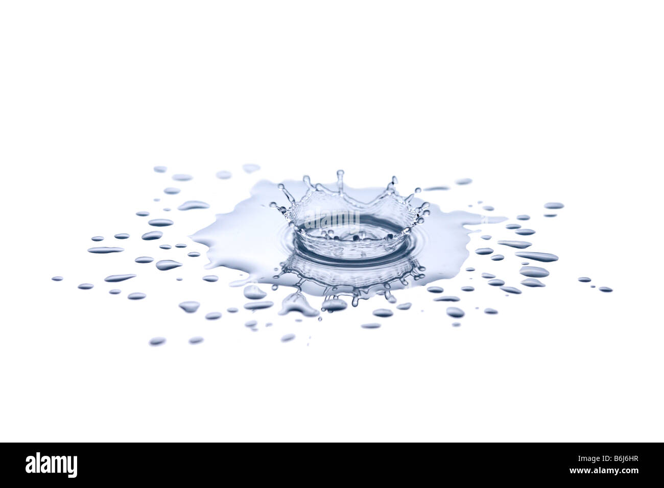 Single drip of water splashing into small puddle of water - Stock Image