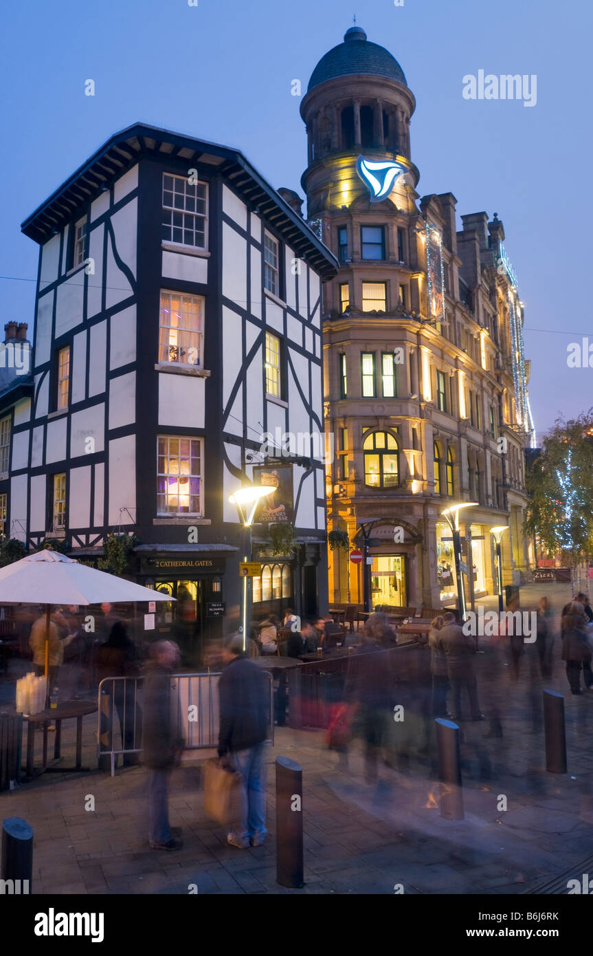 The Shambles Cathedral Gates Hanging Ditch the Triangle shopping centre Manchester early evening December - Stock Image