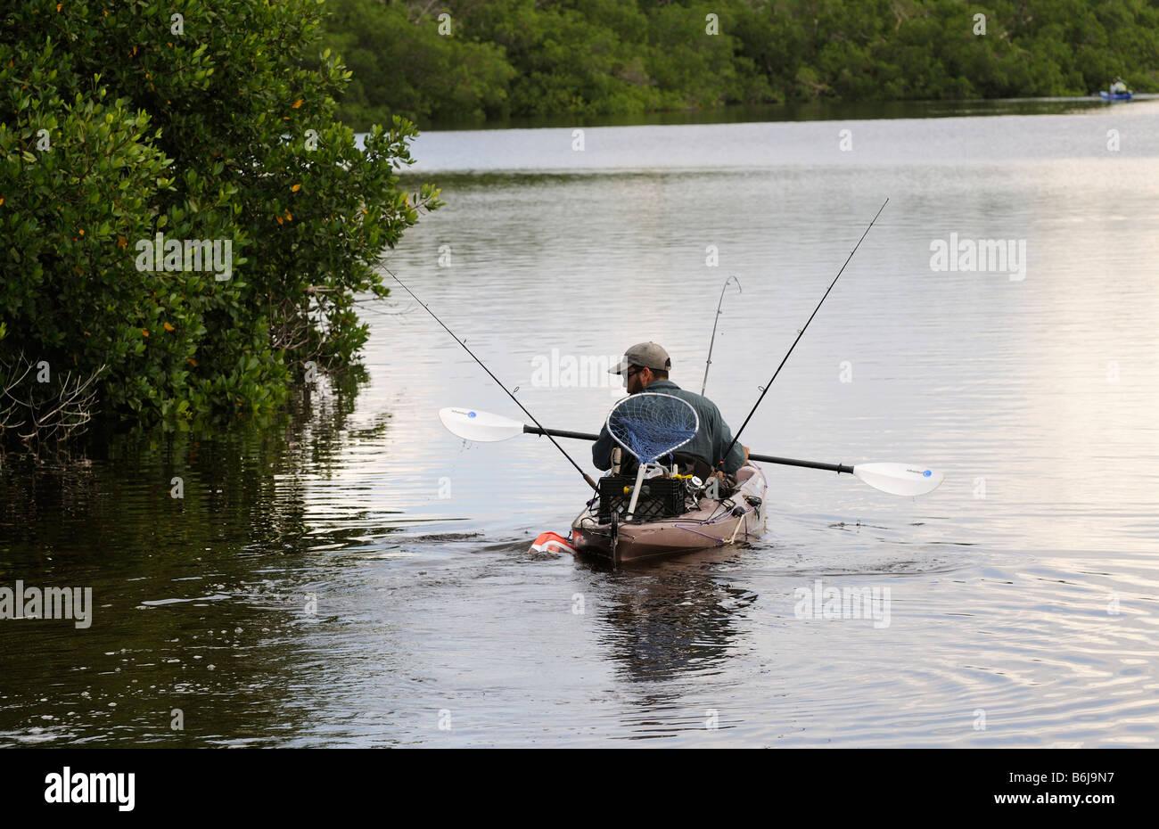 J N Ding Darling National Wildlife Refuge man fishing from Kayak Sanibel Island Florida USA - Stock Image