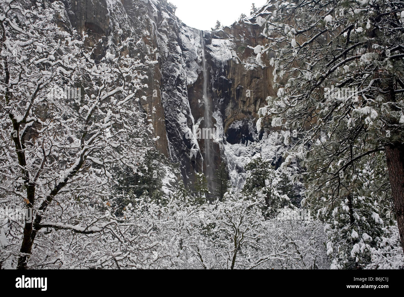 CALIFORNIA -  Bridalveil Falls after a winter snow storm in the Yosemite Valley area of Yosemite National Park. Stock Photo