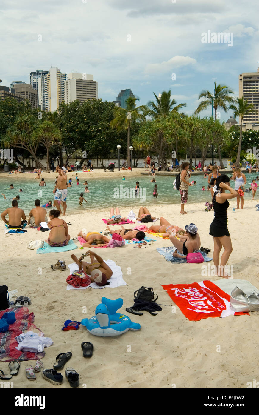 Families relaxing at the man-made Streets Beach, Brisbane, Australia - Stock Image