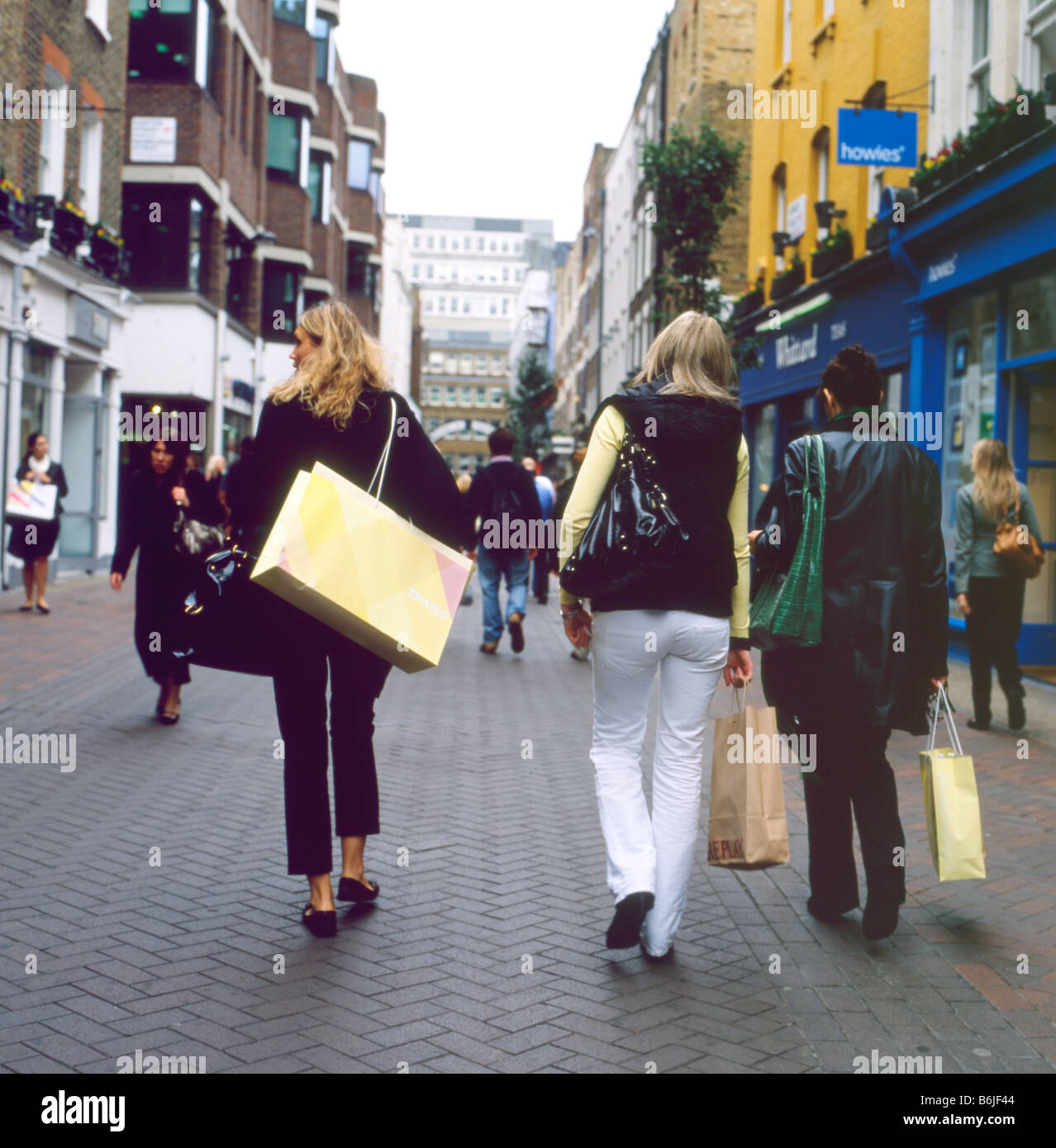 Christmas shoppers with shopping bags on Carnaby Street London UK KATHY DEWITT - Stock Image