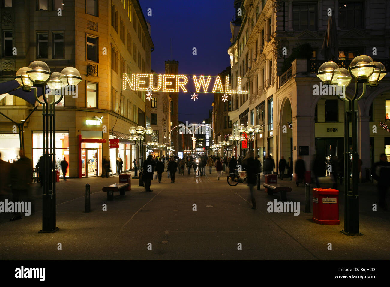 The illuminated city center and high end shopping mall of Neuer Wall in Hamburg, Germany Stock Photo