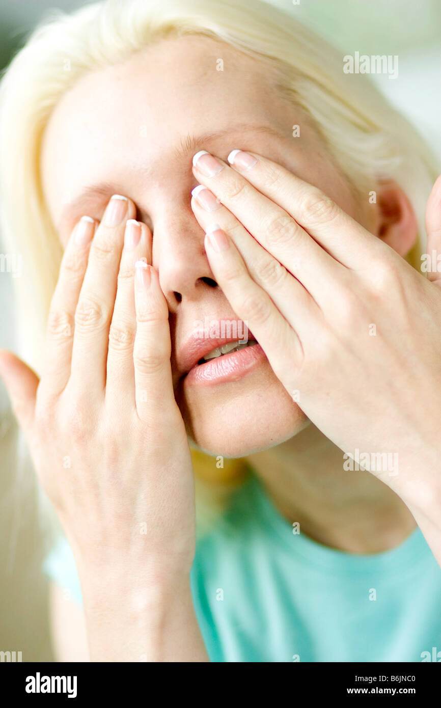 Girl rubbing eyes - Stock Image