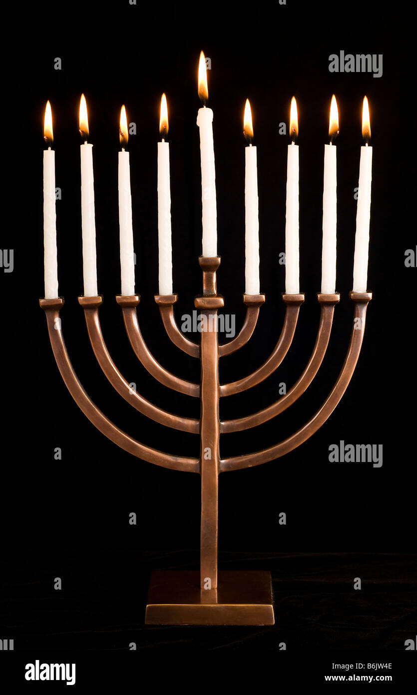 Beautiful lit hanukkah menorah on black velvet - Stock Image