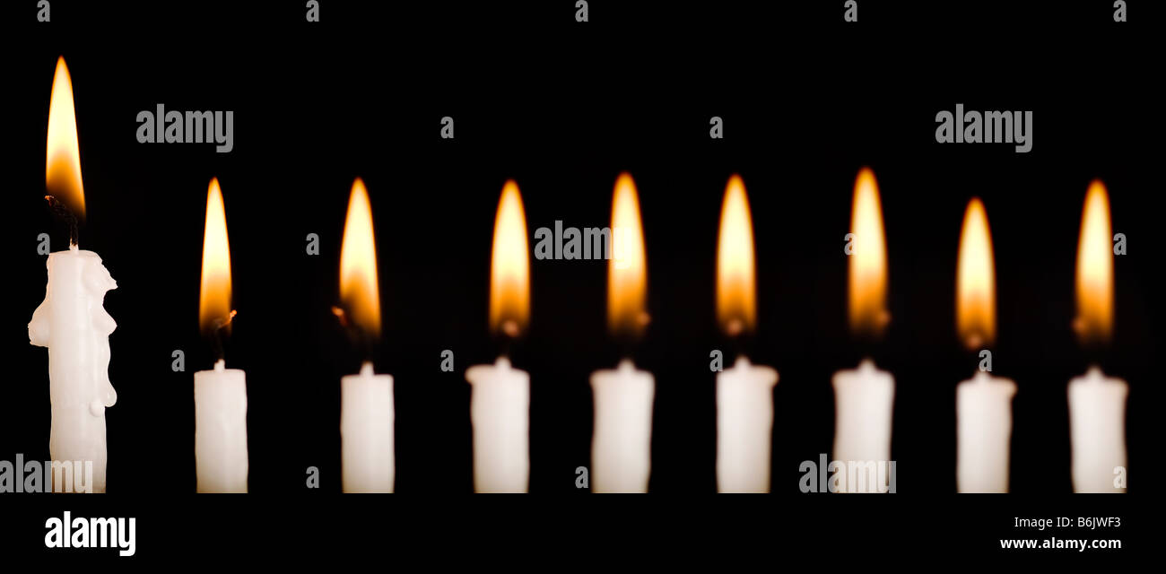 Beautiful lit hanukkah candles on black - Stock Image