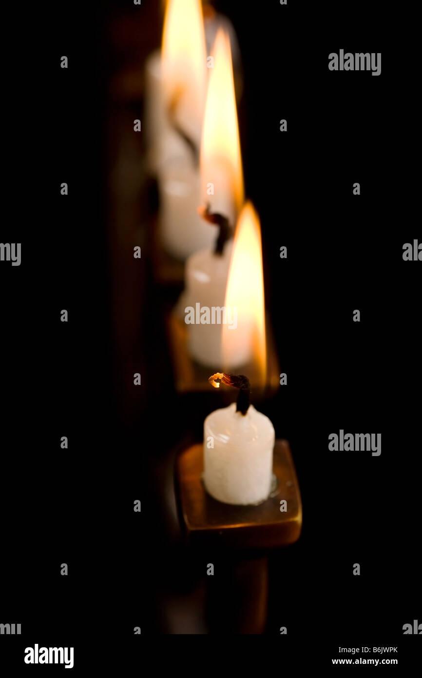 Beautiful lit hanukkah menorah on black - Stock Image