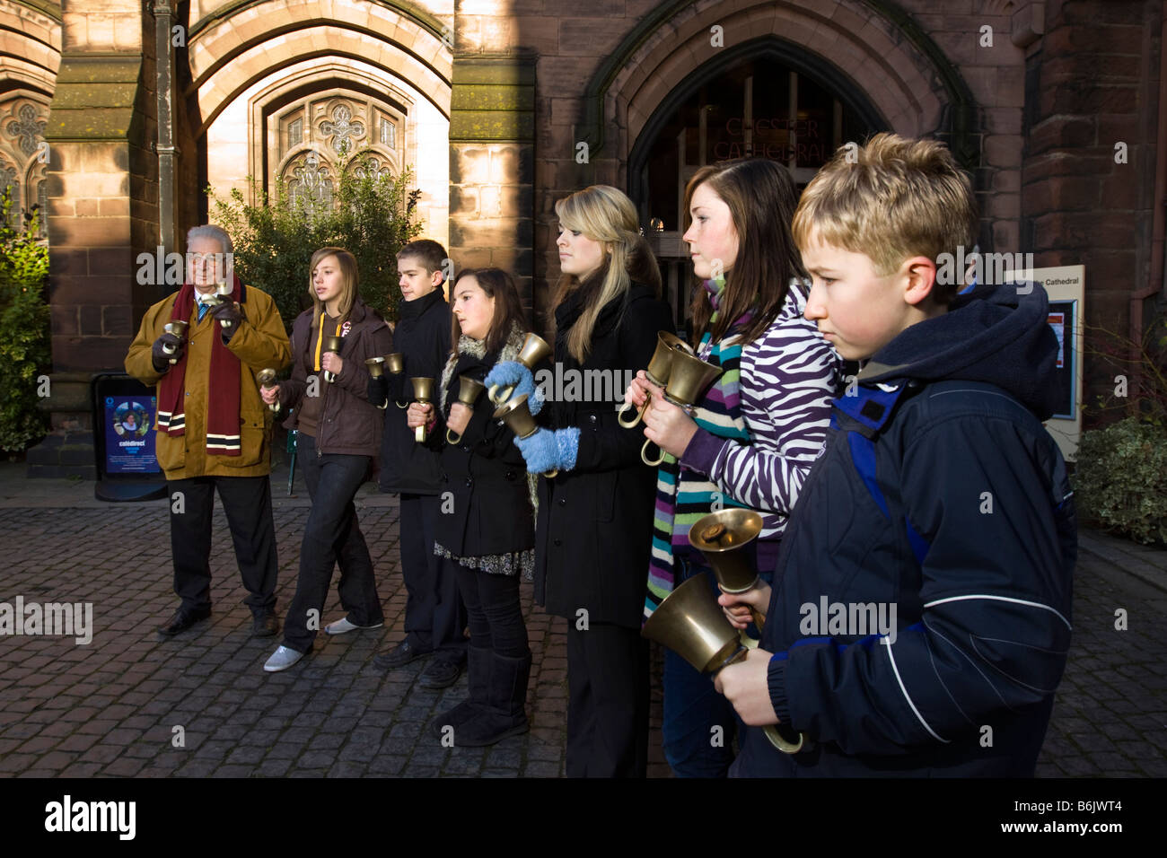 UK Cheshire Chester Cathedral Bishops School hand bell ringers raising money for charity - Stock Image