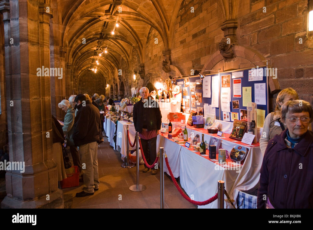 UK Cheshire Chester Cathedral cloister tombola stall raising funds for charity - Stock Image