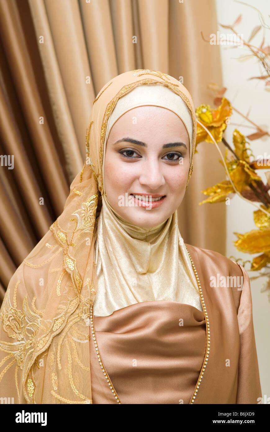 Portrait of a beautiful young Muslim woman wearing Hijab Stock Photo