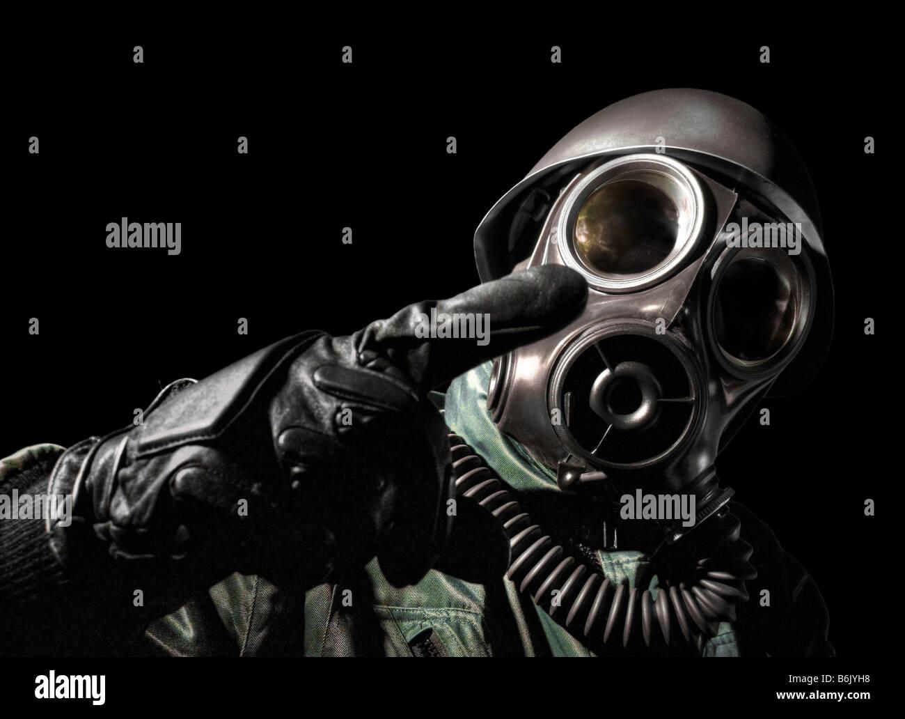 Gas masked man pointing - Stock Image